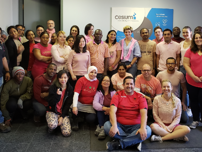 The Cesium team all dressed in pink shirts